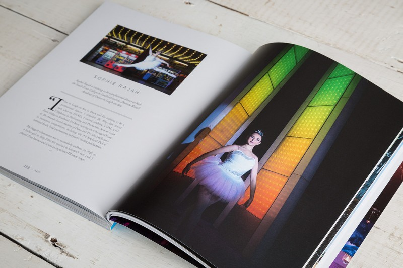 An open page of Salt magazine of a ballerina outside the arcades