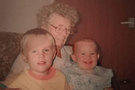 A young Darren with his Nan and Sister