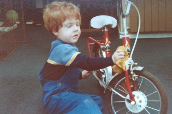 A young Ed cleaning his bike