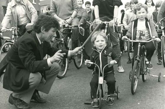 A young Richard riding his bike